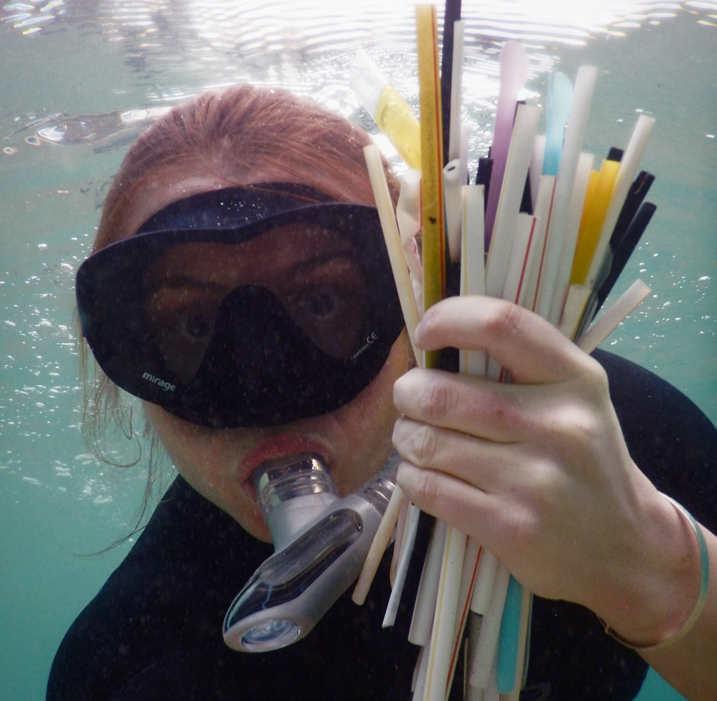 Kasey snorkelling and collecting straws